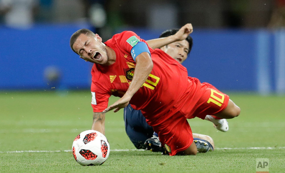 Belgium's Eden Hazard is fouled by Japan's Gaku Shibasaki during the round of 16 match between Belgium and Japan at the 2018 soccer World Cup in the Rostov Arena, in Rostov-on-Don, Russia, Monday, July 2, 2018. (AP Photo/Petr David Josek)