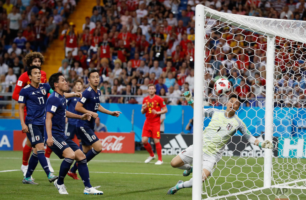 Japan goalkeeper Eiji Kawashima, right, fails to save a ball as Belgium's Jan Vertonghen, center, scores his first side's goal during the round of 16 match between Belgium and Japan at the 2018 soccer World Cup in the Rostov Arena, in Rostov-on-Don, Russia, Monday, July 2, 2018. (AP Photo/Rebecca Blackwell)