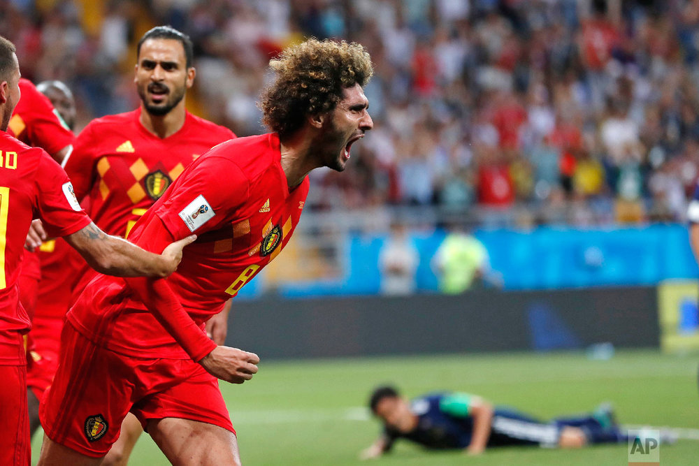 Belgium's Marouane Fellaini celebrates after scoring his side's second goal during the round of 16 match between Belgium and Japan at the 2018 soccer World Cup in the Rostov Arena, in Rostov-on-Don, Russia, Monday, July 2, 2018. (AP Photo/Natacha Pisarenko)