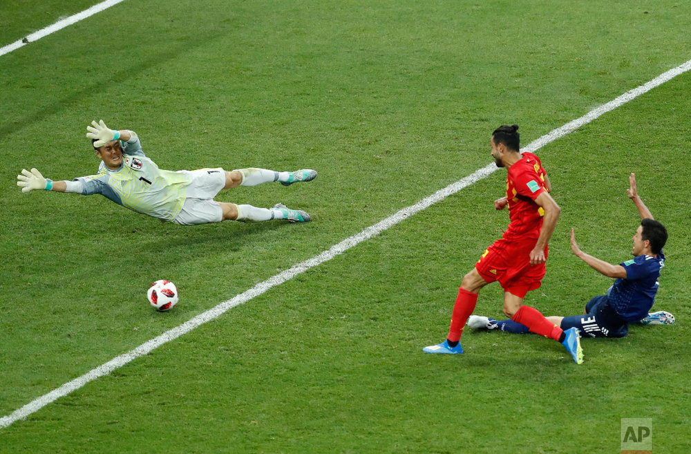 Belgium's Nacer Chadli, center, scores his third side goal during the round of 16 match between Belgium and Japan at the 2018 soccer World Cup in the Rostov Arena, in Rostov-on-Don, Russia, Monday, July 2, 2018. (AP Photo/Hassan Ammar)