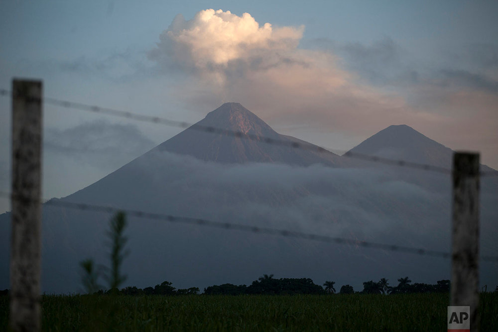 The Volcano of Fire blows a cloud of ash, seen from Palin, Guatemala, June 11, 2018. (AP Photo/Moises Castillo)