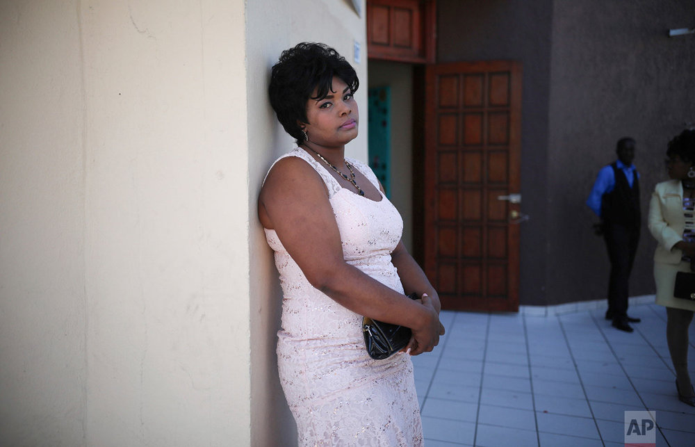 In this May 5, 2018 photo published in June, a Haitian migrant bride waits for the start of a group wedding at the First Baptist Church of Tijuana, Mexico. (AP Photo/Emilio Espejel)