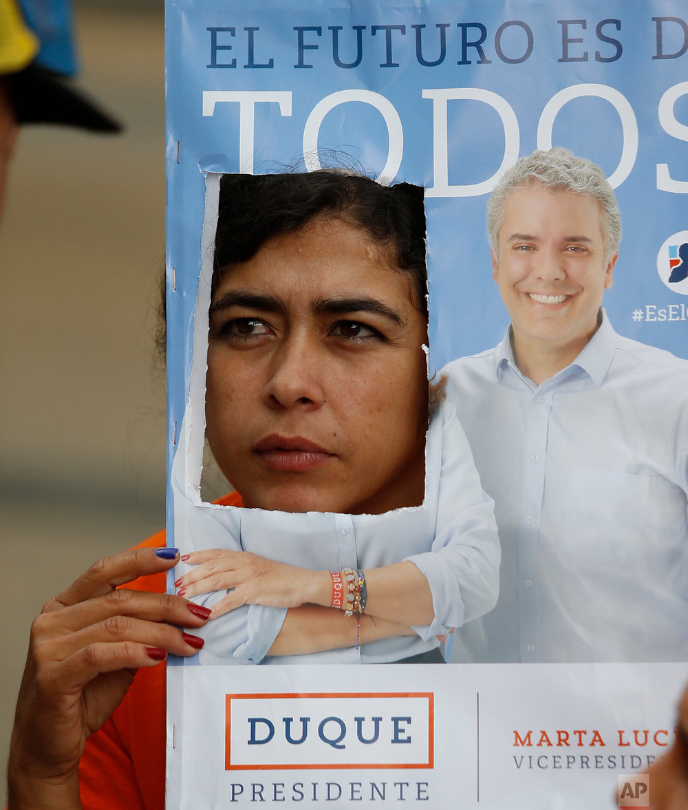 A supporter of presidential candidate Ivan Duque attends his campaign rally in Armenia, Colombia, June 10, 2018. Duque, a former senator and protege of former President Alvaro Uribe, won the contest over Gustavo Petro, a former rebel and Bogota mayor. (AP Photo/Fernando Vergara)