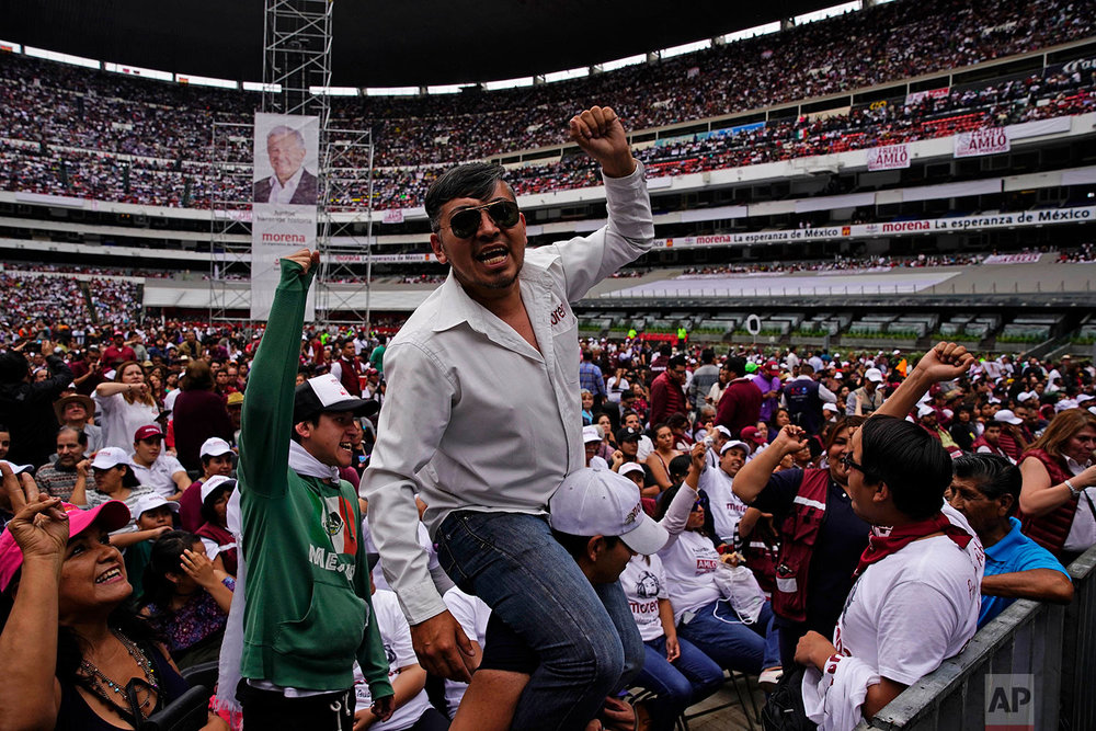 Supporters of presidential candidate Andres Manuel Lopez Obrador wait for their candidate's arrival during his closing campaign rally at Azteca stadium in Mexico City, June 27, 2018. (AP Photo/Ramon Espinosa)