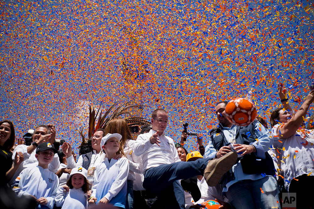 Presidential candidate Ricardo Anaya kicks a soccer ball to supporters during his campaign rally in Mexico City, June 24, 2018. (AP Photo/Ramon Espinosa)
