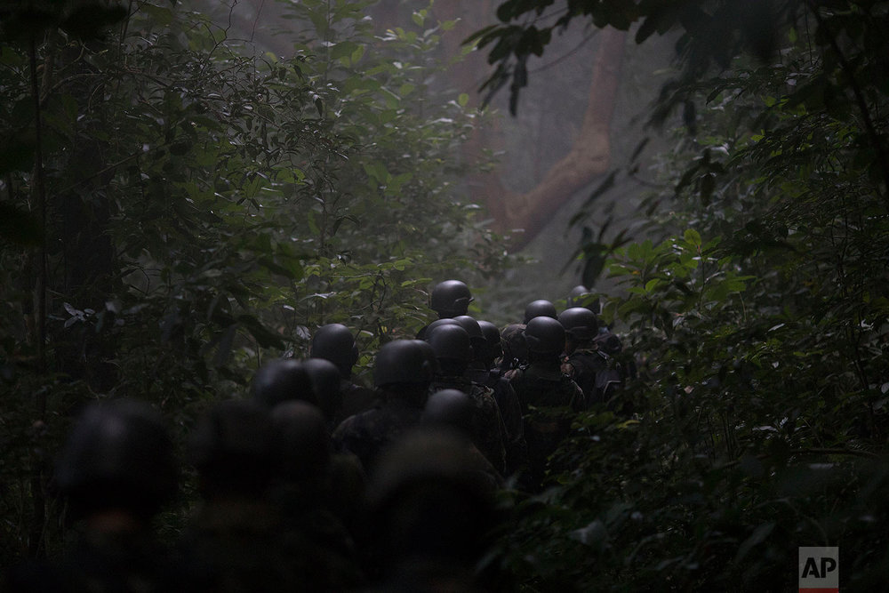 Soldiers patrol the forest above Chapeu Mangueira slum in Rio de Janeiro, Brazil, June 21, 2018. (AP Photo/Leo Correa)