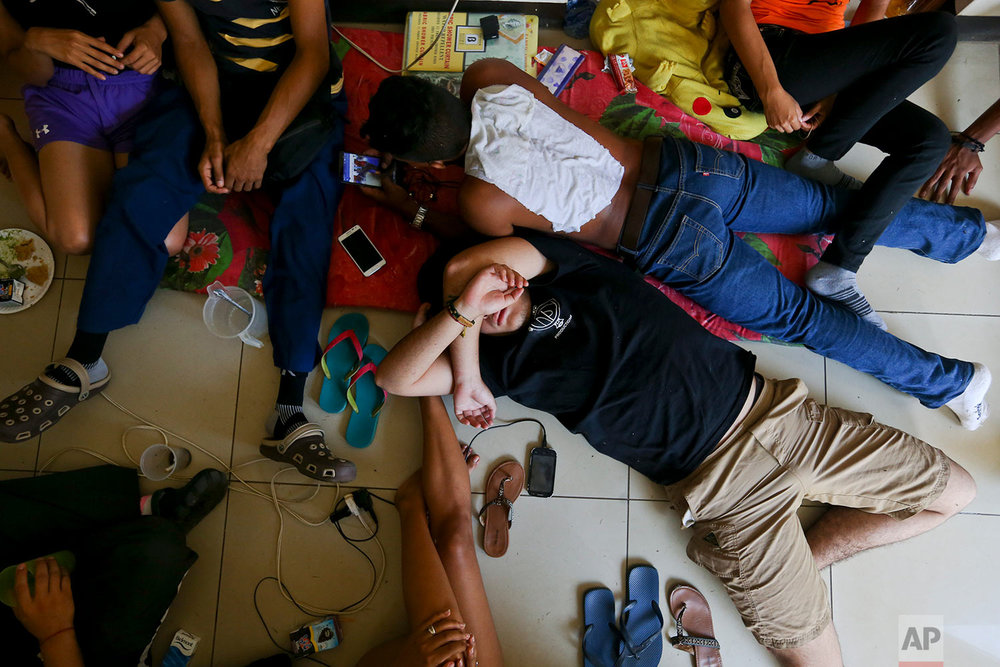 In this June 1, 2018 photo, anti-government students rest inside the Autonomous University of Nicaragua where they have barricaded themselves on campus for protection from government security forces and armed supporters in Managua, Nicaragua. (AP Photo/Esteban Felix)