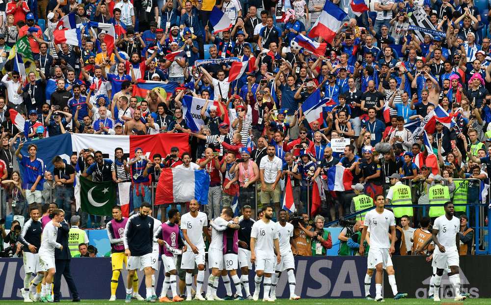 France players and supporters celebrate after the quarterfinal match between Uruguay and France at the 2018 soccer World Cup in the Nizhny Novgorod Stadium, in Nizhny Novgorod, Russia, Friday, July 6, 2018. (AP Photo/Martin Meissner)