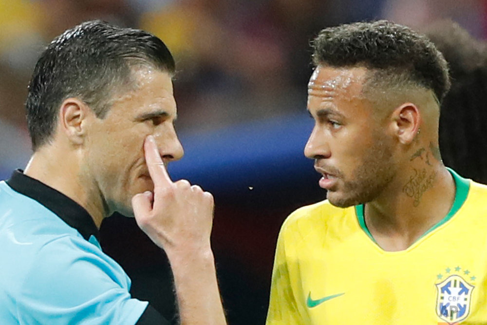 Referee Milorad Mazic from Serbia, left, gestures as he speaking to Brazil's Neymar during the quarterfinal match between Brazil and Belgium at the 2018 soccer World Cup in the Kazan Arena, in Kazan, Russia, Friday, July 6, 2018. (AP Photo/Frank Augstein)