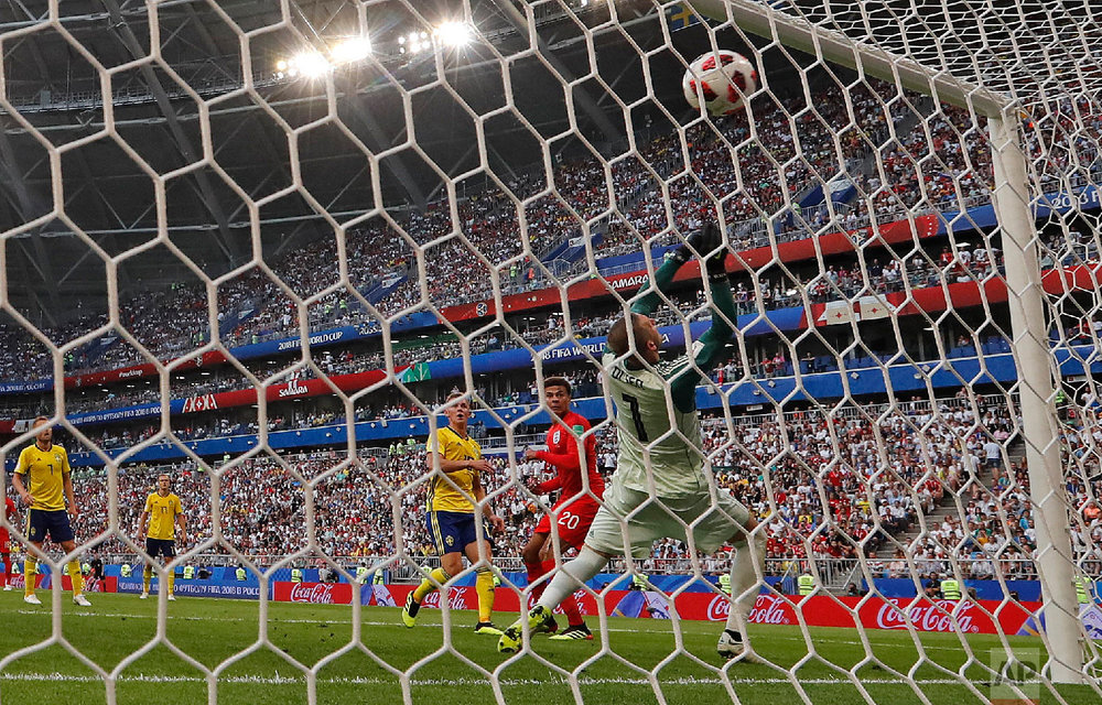 England's Dele Alli, second right, scores his side's second goal during the quarterfinal match between Sweden and England at the 2018 soccer World Cup in the Samara Arena, in Samara, Russia, Saturday, July 7, 2018. (AP Photo/Frank Augstein)