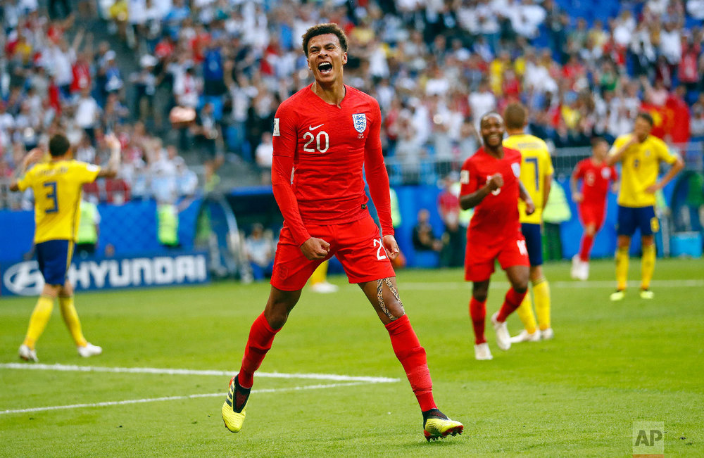 England's Dele Alli celebrates after scoring his side's second goal during the quarterfinal match between Sweden and England at the 2018 soccer World Cup in the Samara Arena, in Samara, Russia, Saturday, July 7, 2018. (AP Photo/Matthias Schrader)
