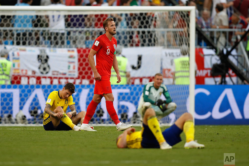 England's Harry Kane walks past Sweden's players at the end of the match after his team beat Sweden 2-0 in the quarterfinal match between Sweden and England at the 2018 soccer World Cup in the Samara Arena, in Samara, Russia, Saturday, July 7, 2018. (AP Photo/Francisco Seco)