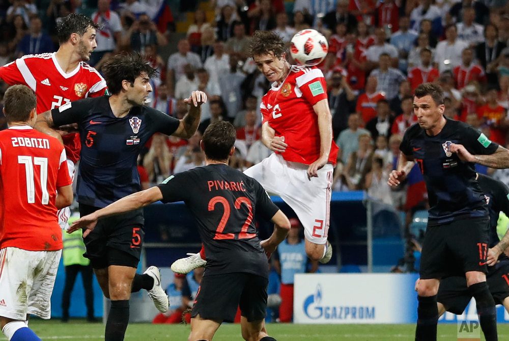 Russia's Mario Fernandes , centre, scores his side's second goal during the quarterfinal match between Russia and Croatia at the 2018 soccer World Cup in the Fisht Stadium, in Sochi, Russia, Saturday, July 7, 2018. (AP Photo/Darko Bandic)