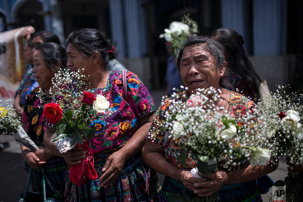 In this June 20, 2018 photo, Prudencia Machan, 76, who's daughter has been missing since 1981, cries as she attends the funeral ceremony for 172 unidentified people who were discovered buried on what was once a military camp, one day before their proper burial in San Juan Comalapa, Guatemala. (AP Photo/Rodrigo Abd)