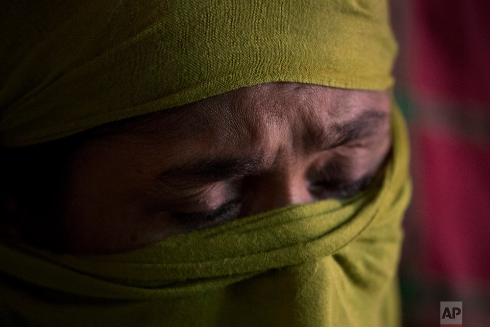 """D"" recounts her experience of the rape she endured being so severe that she had to wrap a supportive scarf around her battered pelvis to endure the days long walk to Bangladesh, in her shelter in Kutupalong refugee camp, Bangladesh, June 25, 2018. (AP Photo/Wong Maye-E)"