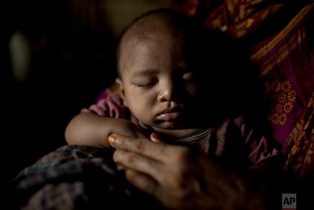 """S"" holds her baby boy as she sits in her shelter in Balukhali refugee camp in Bangladesh, June 25, 2018. (AP Photo/Wong Maye-E)"