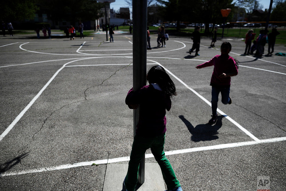 Children play at recess at John G. Carlisle Elementary School in Covington, Ky., on April 27, 2018. At least three students here had a parent arrested in December when ICE agents arrested people in Covington and four other cities. (AP Photo/Gregory Bull)