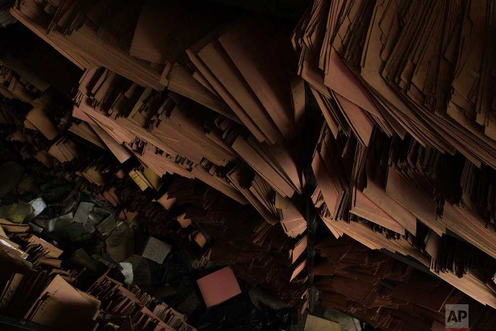 Shelves of paper files are stacked in a 2,600-square meter listed building from 1955, formerly used by a commerce fund company. (AP Photo/Petros Giannakouris)
