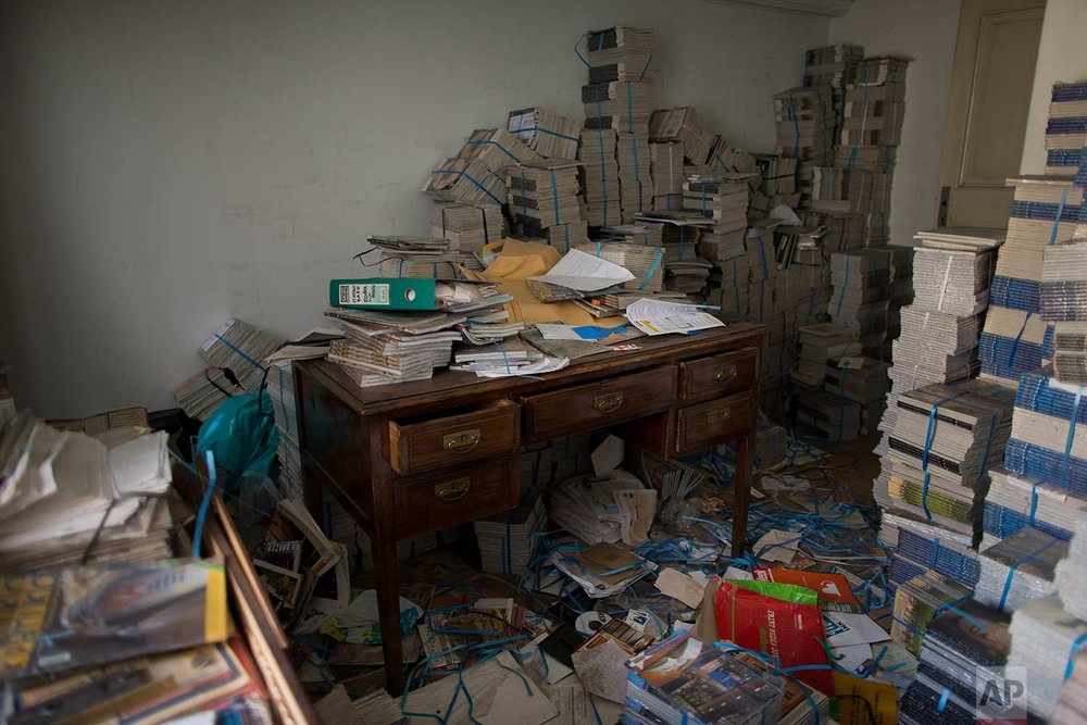 Stacks of magazines in an office in one of Athens' few substantial late 19th century buildings to survive brutal postwar development. (AP Photo/Petros Giannakouris)