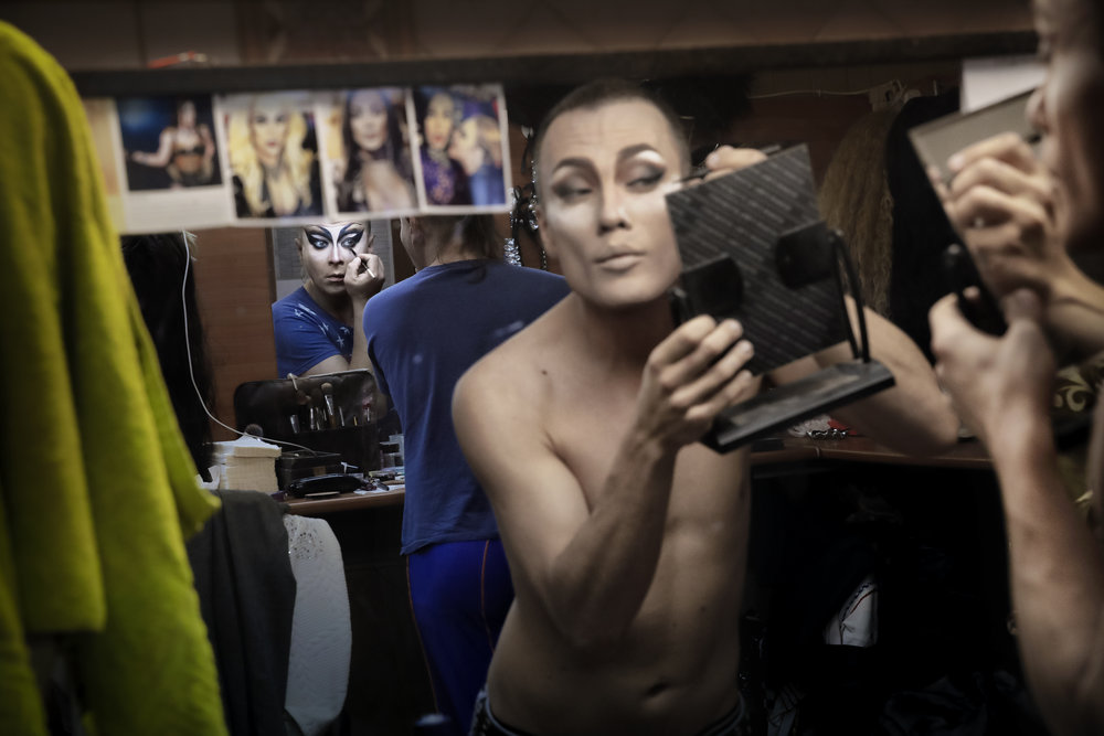 Sergey, left, who uses the stage name Bomba (the bomb), and Andrei, who goes by the name of Star Vasha apply make-up backstage before performing at the Fame gay club during the 2018 soccer World Cup in Yekaterinburg, Russia. (AP Photo/Vadim Ghirda)
