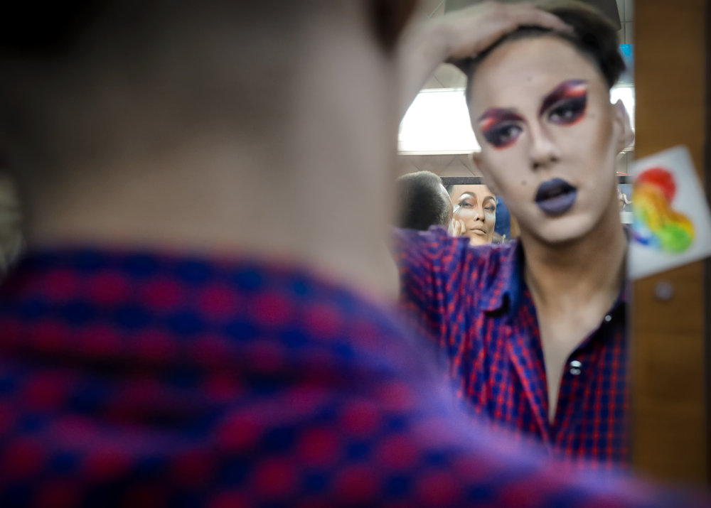 Andrei, center background, who goes by the stage name of Star Vasha and Dmitry, who performs under the name of Africa, apply make-up backstage before performing at the Fame gay club during the 2018 soccer World Cup in Yekaterinburg, Russia. (AP Photo/Vadim Ghirda)