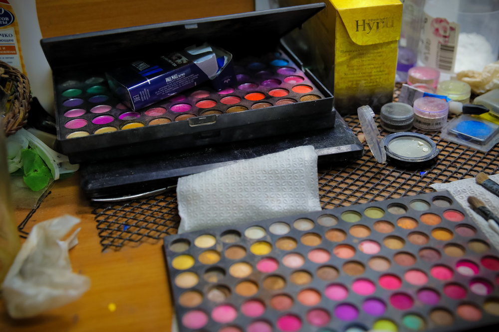 Make-up kits lie on a desk backstage at the Fame gay club during the 2018 soccer World Cup in Yekaterinburg, Russia. (AP Photo/Vadim Ghirda)