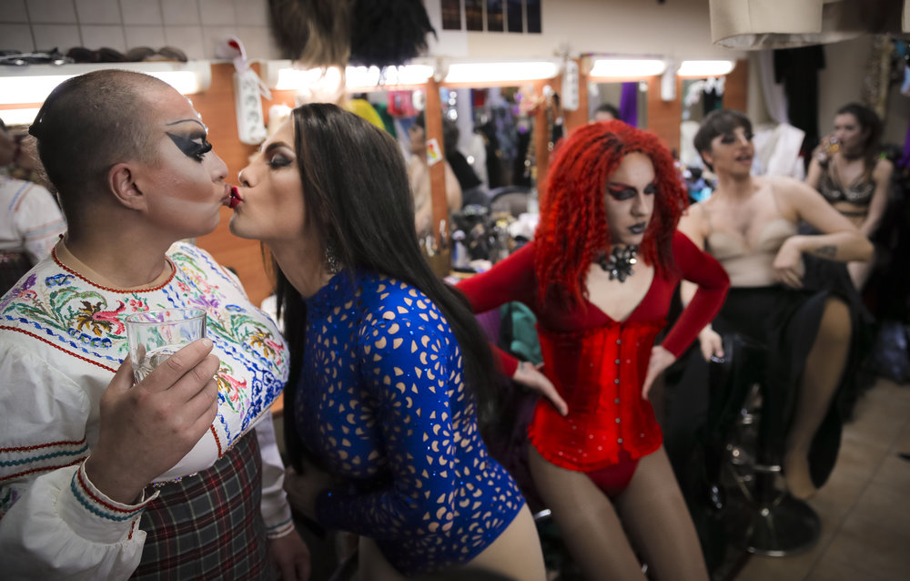 Sergey, left, who uses the stage name Bomba (the bomb), and Andrei, who goes by the name of Star Vasha, share a pre-show kiss, barely touching so as not to smudge their flawless lipstick, at the Fame gay club during the 2018 soccer World Cup in Yekaterinburg, Russia. (AP Photo/Vadim Ghirda)