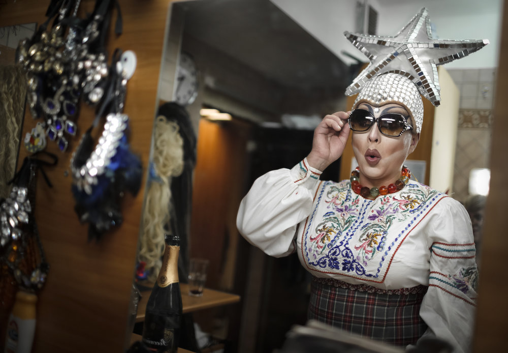 Sergey, who uses the stage name Bomba (the bomb) checks an outfit before performing a traditional Russian dance at the Fame gay club, during the 2018 soccer World Cup in Yekaterinburg, Russia. (AP Photo/Natacha Pisarenko)