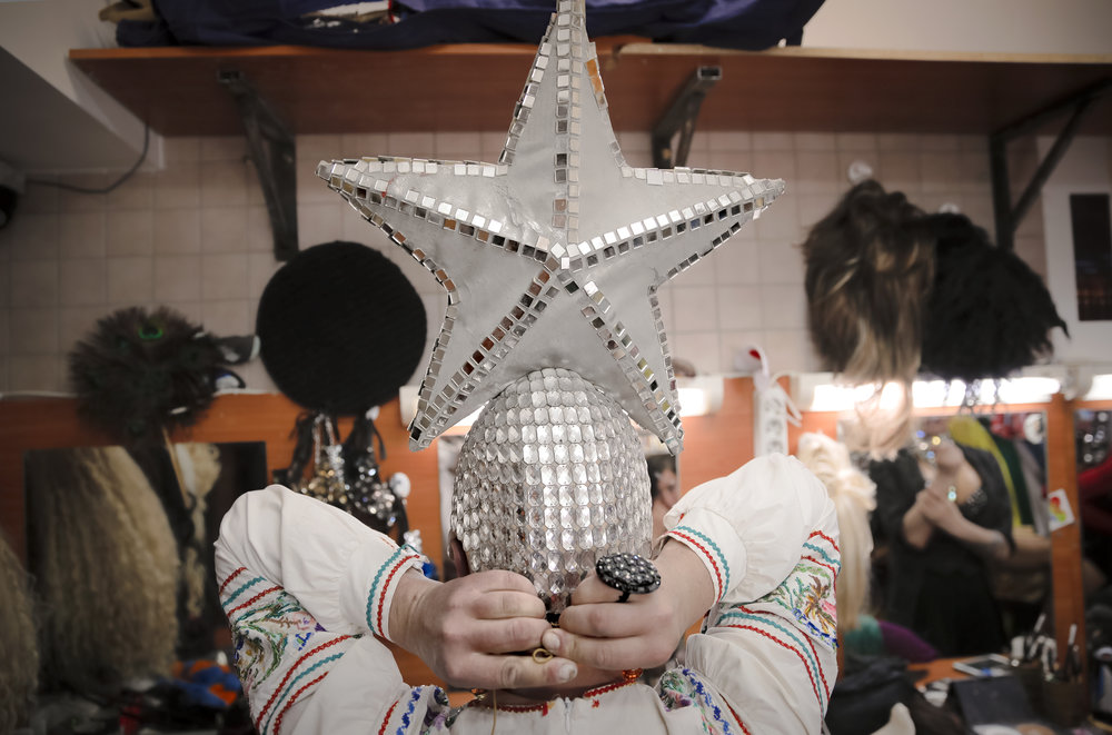 Sergey, who uses the stage name Bomba (the bomb) puts on a necklace before performing a traditional Russian dance at the Fame gay club, during the 2018 soccer World Cup in Yekaterinburg, Russia. (AP Photo/Vadim Ghirda)