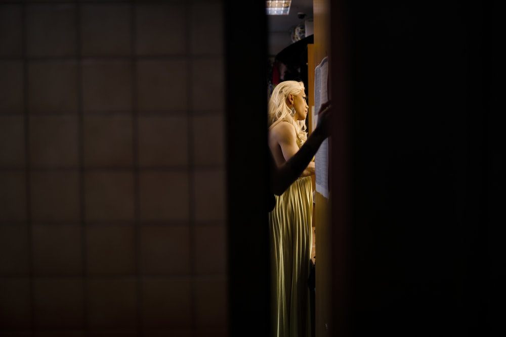 Andrei, who uses the stage name Star Vasha, looks in the mirror during a break between performances at the Fame gay club, during the 2018 soccer World Cup in Yekaterinburg, Russia on Sunday, June 24, 2018 (AP Photo/Natacha Pisarenko)
