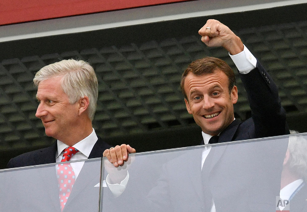French President Emmanuel Macron, right, clenches a fist as he stands beside King Philippe of Belgium prior to the semifinal match between France and Belgium at the 2018 soccer World Cup in the St. Petersburg Stadium in St. Petersburg, Russia, Tuesday, July 10, 2018. (AP Photo/Martin Meissner)