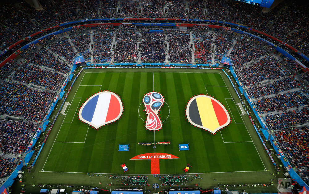 Belgium's and french flags are displayed prior to the semifinal match between France and Belgium at the 2018 soccer World Cup in the St. Petersburg Stadium in St. Petersburg, Russia, Tuesday, July 10, 2018. (AP Photo/Dmitri Lovetsky)