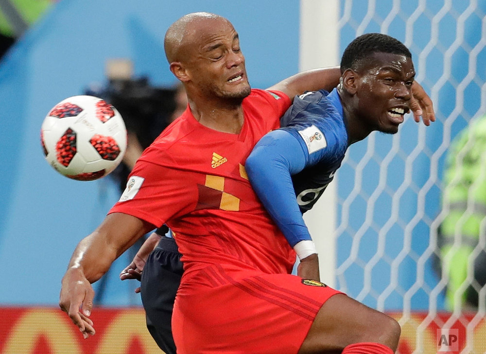 BelBelgium's Vincent Kompany, left, and France's Paul Pogba vie for the ball during the semifinal match between France and Belgium at the 2018 soccer World Cup in the St. Petersburg Stadium, in St. Petersburg, Russia, Tuesday, July 10, 2018. (AP Photo/Petr David Josek)