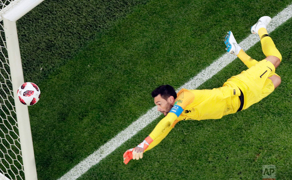 France goalkeeper Hugo Lloris goes for the ball during the semifinal match between France and Belgium at the 2018 soccer World Cup in the St. Petersburg Stadium in St. Petersburg, Russia, Tuesday, July 10, 2018. (AP Photo/Dmitri Lovetsky)