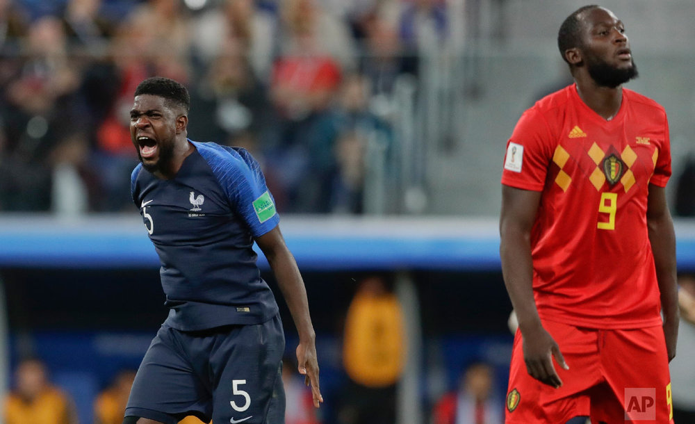 France's Samuel Umtiti celebrates past Belgium's Romelu Lukaku at the end of the semifinal match between France and Belgium at the 2018 soccer World Cup in the St. Petersburg Stadium, in St. Petersburg, Russia, Tuesday, July 10, 2018. France won 1-0. (AP Photo/Petr David Josek)