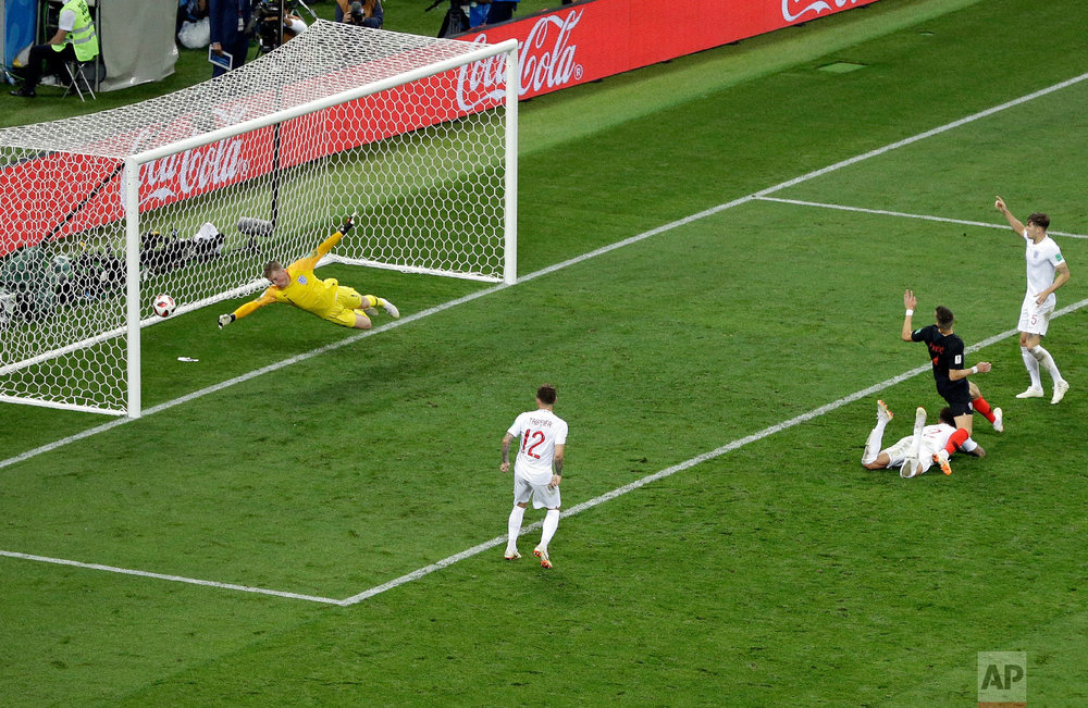 Croatia's Ivan Perisic, 2nd right, scores his side's first goal during the semifinal match between Croatia and England at the 2018 soccer World Cup in the Luzhniki Stadium in Moscow, Russia, Wednesday, July 11, 2018. (AP Photo/Thanassis Stavrakis)