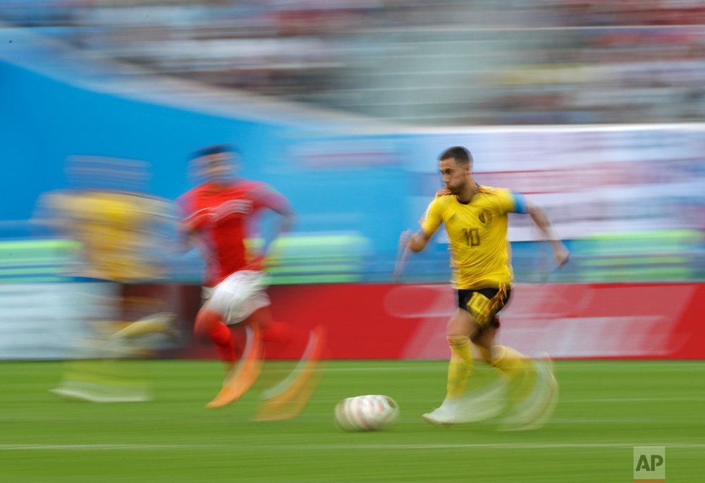 Belgium's Eden Hazard, right, is pursued by England's Jesse Lingard as he runs with the ball during the third place match between England and Belgium at the 2018 soccer World Cup in the St. Petersburg Stadium in St. Petersburg, Russia, Saturday, July 14, 2018. (AP Photo/Petr David Josek)