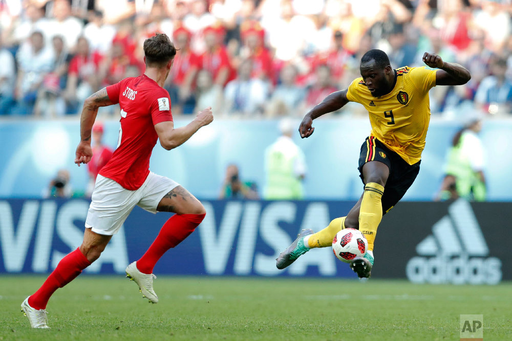 Belgium's Romelu Lukaku, right, controls the ball besides England's John Stones during the third place match between England and Belgium at the 2018 soccer World Cup in the St. Petersburg Stadium in St. Petersburg, Russia, Saturday, July 14, 2018. (AP Photo/Natacha Pisarenko)