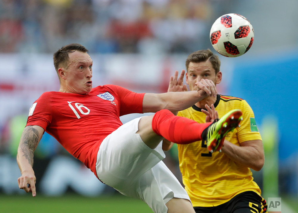 England's Phil Jones left controls a ball in front of Belgium's Jan Vertonghen during the third place match between England and Belgium at the 2018 soccer World Cup in the St. Petersburg Stadium in St. Petersburg, Russia, Saturday, July 14, 2018. (AP Photo/Petr David Josek)