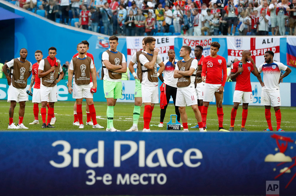England players look on as Belgium is recognized as the third place winner after defeating England in the third place match at the 2018 soccer World Cup in the St. Petersburg Stadium in St. Petersburg, Russia, Saturday, July 14, 2018. (AP Photo/Petr David Josek)