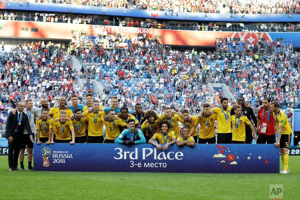 Team Belgium pose after the third place match between England and Belgium at the 2018 soccer World Cup in the St. Petersburg Stadium in St. Petersburg, Russia, Saturday, July 14, 2018. (AP Photo/Natacha Pisarenko)