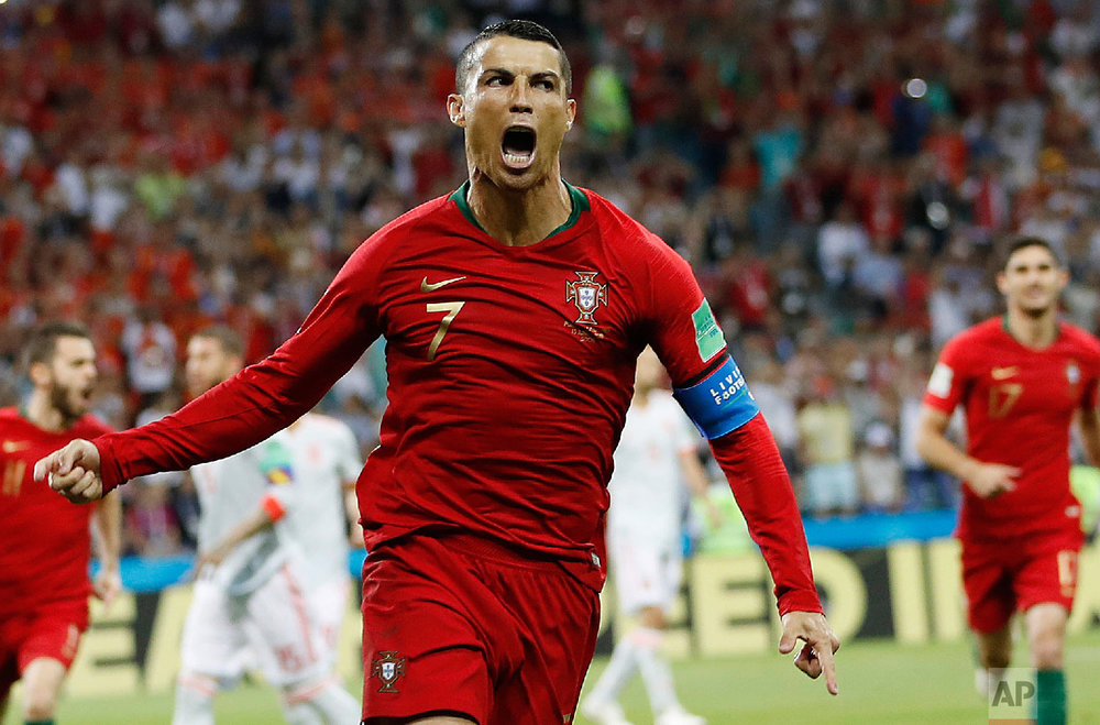Portugal's Cristiano Ronaldo celebrates his side's opening goal during the group B match between Portugal and Spain at the 2018 soccer World Cup in the Fisht Stadium in Sochi, Russia on June 15, 2018. (AP Photo/Francisco Seco)