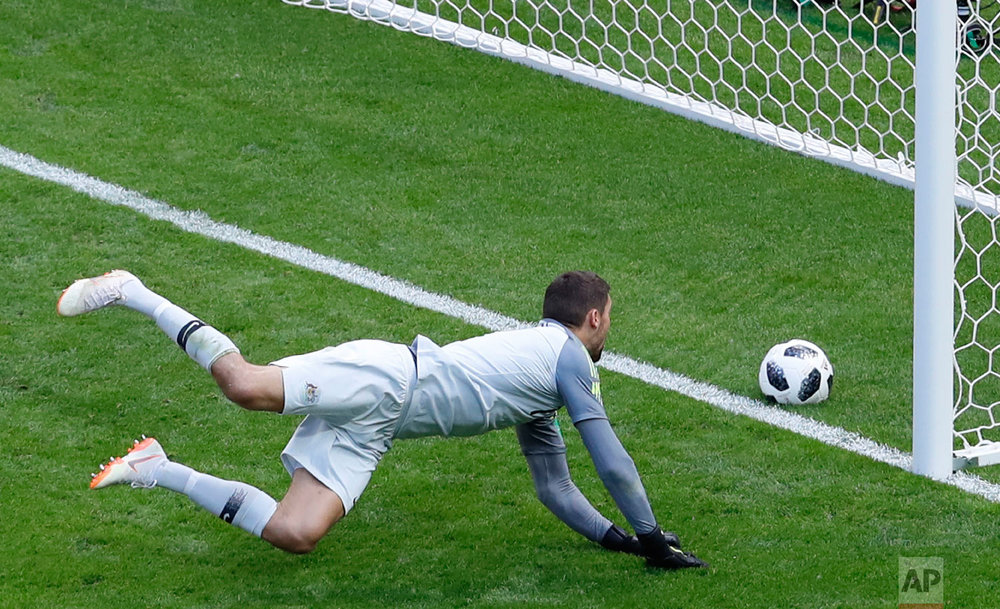 Australia goalkeeper Mathew Ryan fails to save the ball as France's Paul Pogba his side's second goal during the group C match between France and Australia at the 2018 soccer World Cup in the Kazan Arena in Kazan, Russia on June 16, 2018. (AP Photo/Hassan Ammar)