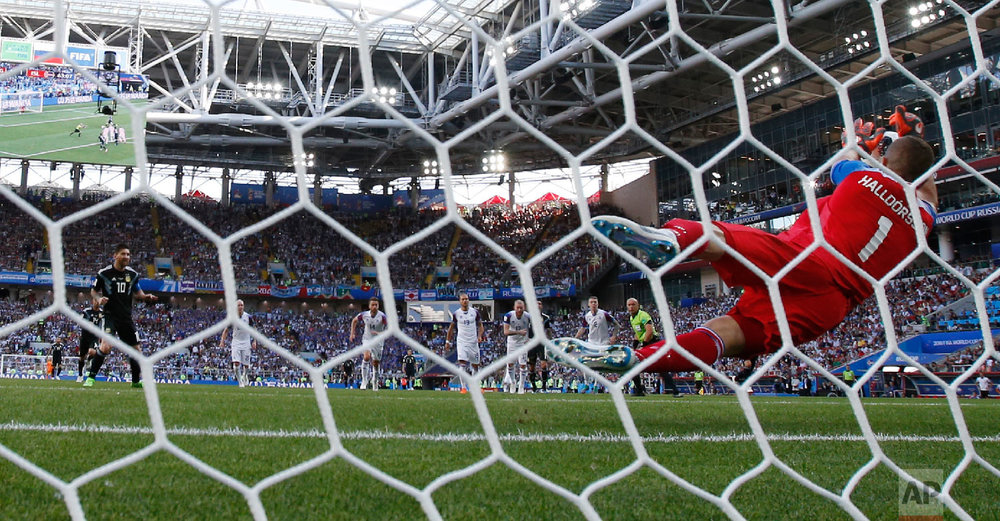 Iceland goalkeeper Hannes Halldorsson, right, saves a penalty by Argentina's Lionel Messi during the group D match between Argentina and Iceland at the 2018 soccer World Cup in the Spartak Stadium in Moscow, Russia on June 16, 2018. (AP Photo/Antonio Calanni)