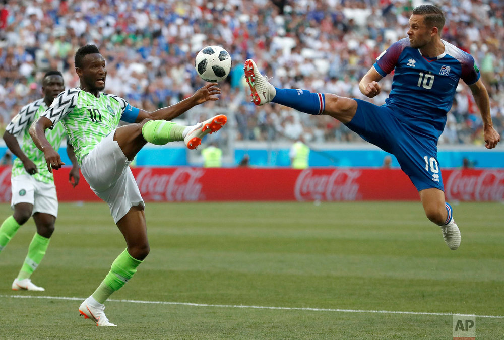 Nigeria's John Obi Mikel, left, and Iceland's Gylfi Sigurdsson compete for the ball during the group D match between Nigeria and Iceland at the 2018 soccer World Cup in the Volgograd Arena in Volgograd, Russia on June 22, 2018. (AP Photo/Darko Vojinovic)
