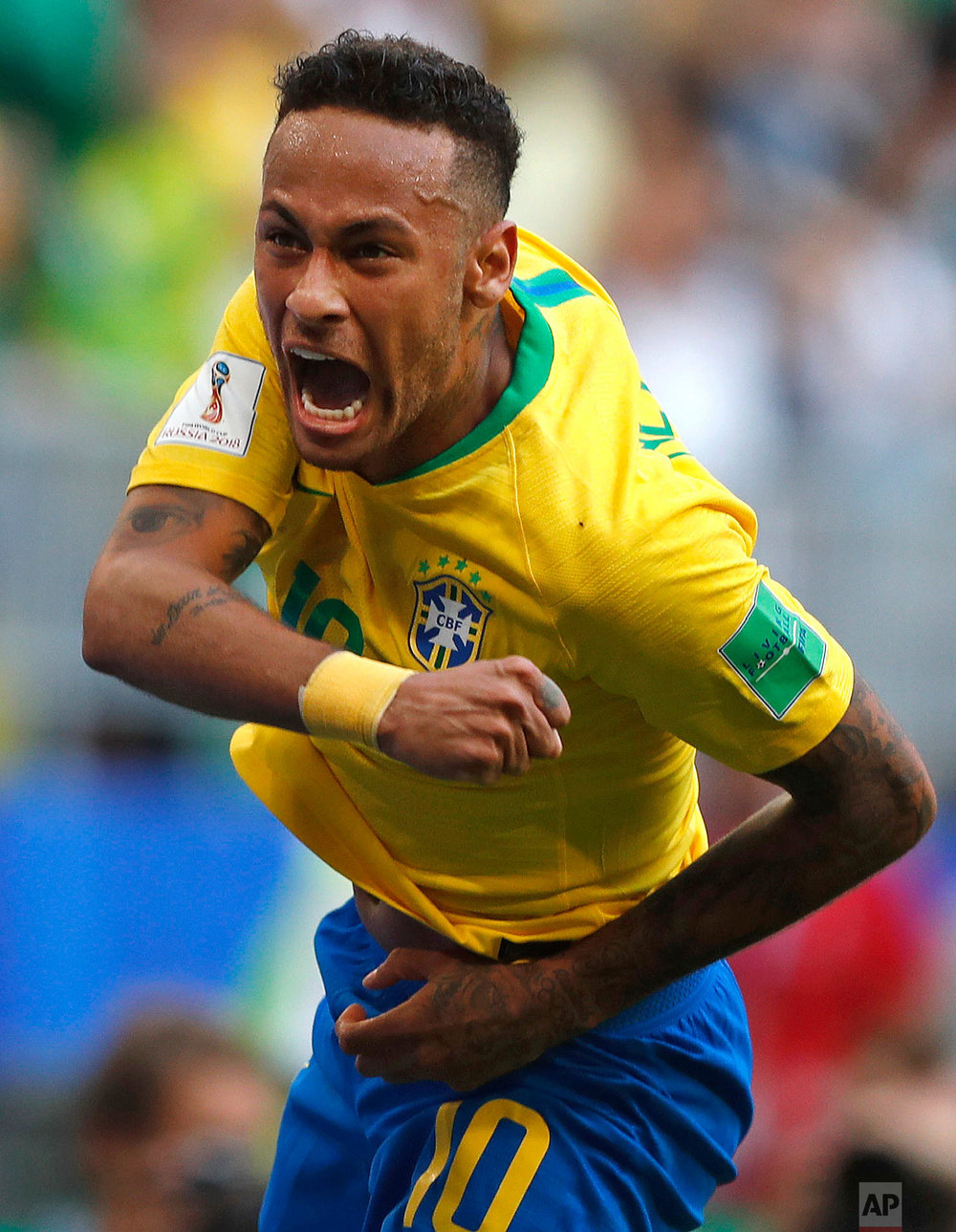 Brazil's Neymar celebrates after scoring his side's opening goal during the round of 16 match between Brazil and Mexico at the 2018 soccer World Cup in the Samara Arena, in Samara, Russia on July 2, 2018. (AP Photo/Frank Augstein)