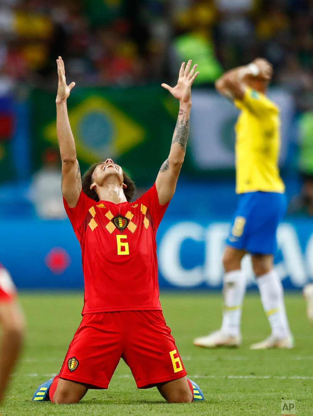 Belgium's Axel Witsel, centre celebrates after the final whistle as Belgium defeat Brazil in their quarterfinal match between Brazil and Belgium at the 2018 soccer World Cup in the Kazan Arena, in Kazan, Russia on July 6, 2018. (AP Photo/Matthias Schrader, File)