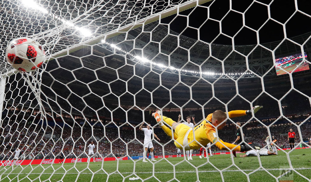 Croatia's Ivan Perisic scores his side's first goal past England goalkeeper Jordan Pickford during the semifinal match between Croatia and England at the 2018 soccer World Cup in the Luzhniki Stadium in Moscow, Russia on July 11, 2018. (AP Photo/Frank Augstein)