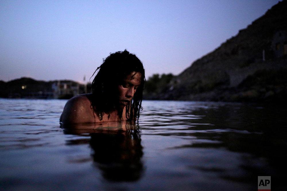 38-year old Nubian Reesha swims in the Nile River on Heisa Island, in Aswan, Egypt.(AP Photo/Nariman El-Mofty)