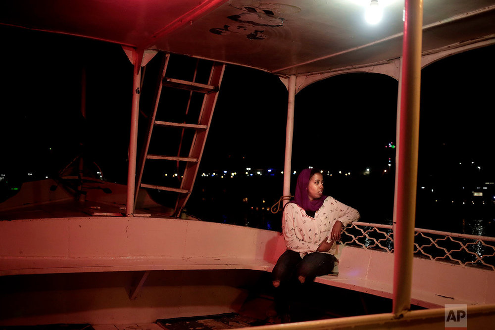 30-year old Nubian activist Siham Othman, sits on a felucca on the Nile River in Aswan, Egypt. (AP Photo/Nariman El-Mofty)